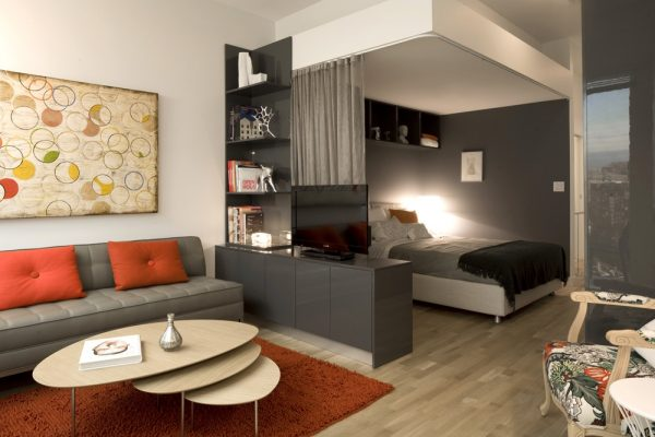 Vinyl-Floor-Ide-wall-and-Furniture-For-contemporary-Small-Living-Room-Space-With-Sofa-Sets-Also-With-Nice-Orange-Cushions-And-Beautiful-Round-Coffee-Table-With-fur-Rug-Area1