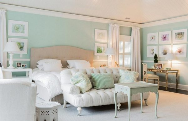 a-glamorous-mint-wall-paint-idea-for-lavish-bedroom-with-stylish-brown-bed-and-white-bedding-with-antique-wooden-tables-and-classy-white-sofa-and-fascinating-wall-decors-1024x663